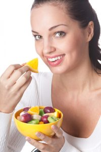 Non-Surgical Heartburn Treatment-Girl eating fruit
